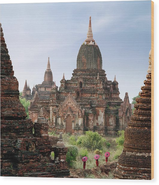Buddhist Monks Walking Past Temple Wood Print by Martin Puddy