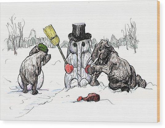 Building A Snow Elephant Wood Print