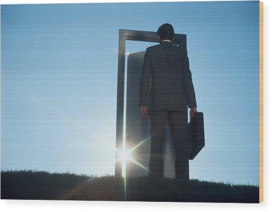 Businessman Entering Door Outdoors Wood Print by Comstock