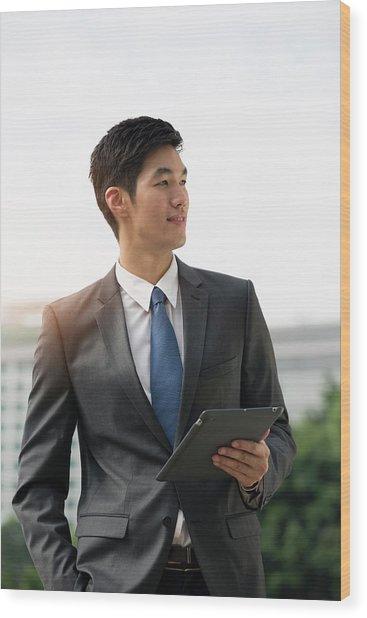 Businessman Holding Digital Tablet Wood Print