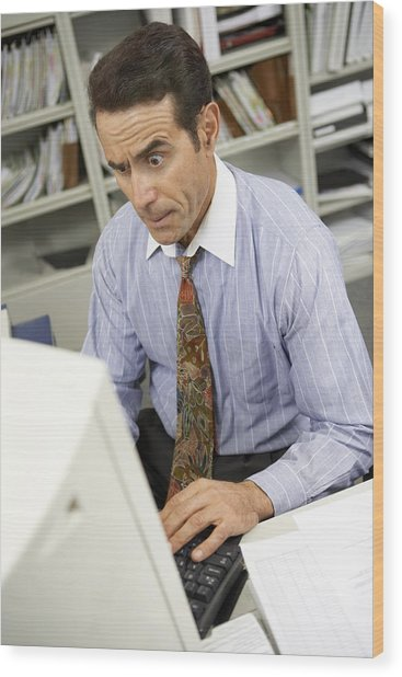 Businessman Working On Computer Wood Print by BananaStock