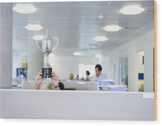 Businesswoman Holding Trophy Over Office Cubicle Wood Print by Jacobs Stock Photography Ltd