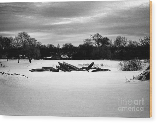 Canoes In The Snow - Monochrome Wood Print