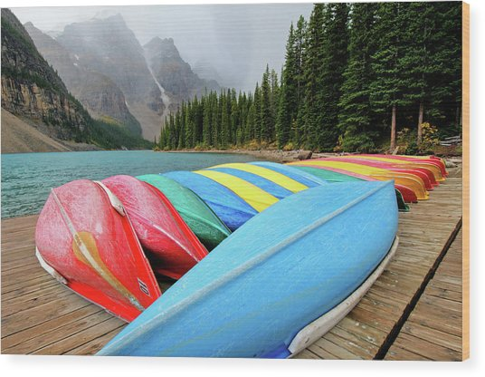Canoes Line Dock At Moraine Lake, Banff Wood Print by Wildroze