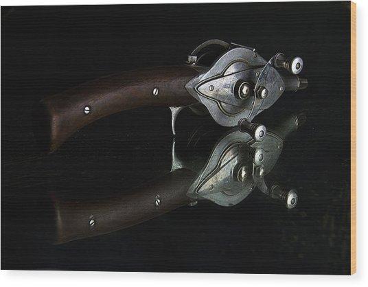 Casting Reel Wood Print by Julian Riojas