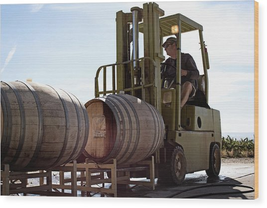 Caucasian Farmer Driving Forklift With Wood Print