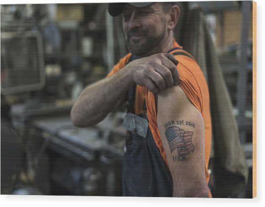 Caucasian Worker Displaying Tattoo In Factory Wood Print by Jetta Productions Inc