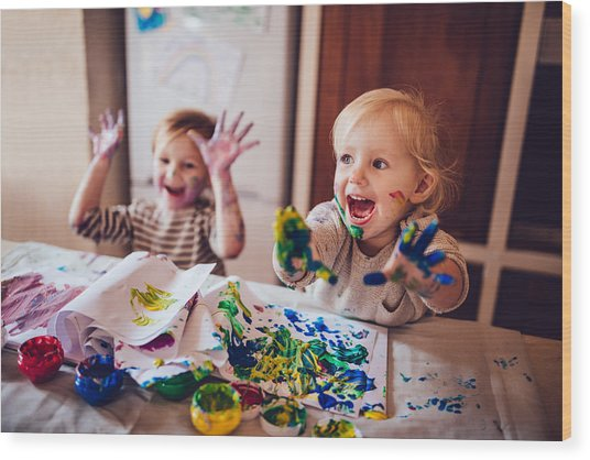 Cheerful Little Children Having Fun Doing Finger Painting Wood Print by Wundervisuals