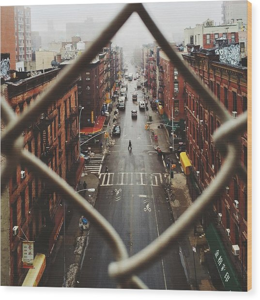 Chinatown Seen Through Fence On A Foggy Wood Print by Alexander Spatari