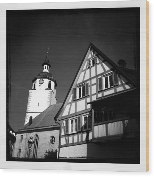 Church And Half-timbered House In Lovely Old Town Wood Print