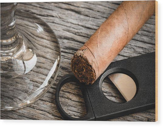 Cigar And Cutter With Glass Of Brandy Or Whiskey On Wooden Backg Wood Print