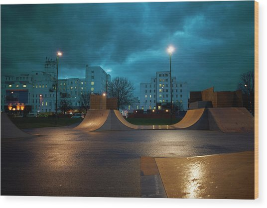 Cityscape And Skateboard Park At Night Wood Print by Peter Muller