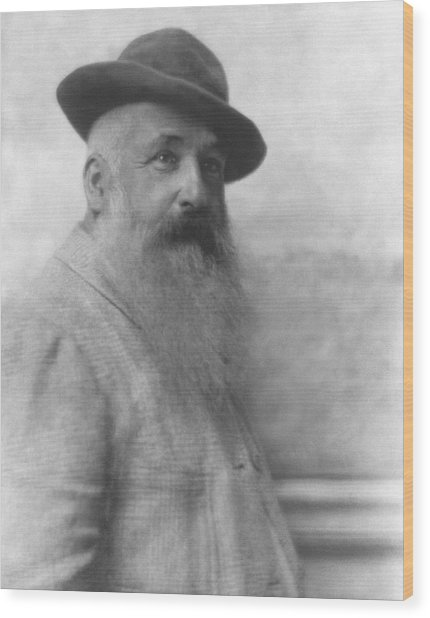 Claude Monet Wearing A Hat Wood Print by Adolphe De Meyer