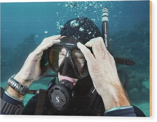 Clearing Water-filled Diving Mask Wood Print