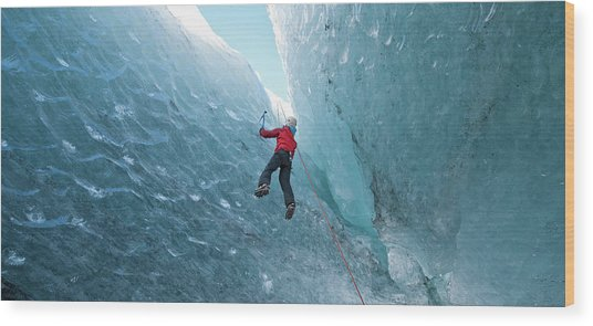 Climber Climbing Out Of Ice Cave Wood Print