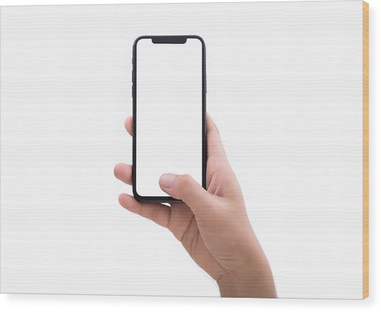 Close Up Hand Hold Phone Isolated On White Wood Print by Issarawat Tattong