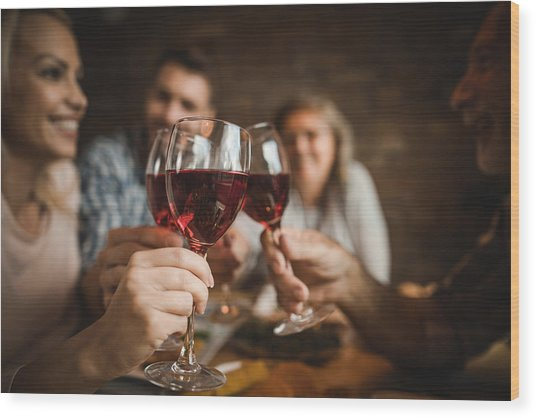 Close Up Of A Family Toasting With Red Wine At Home. Wood Print by Skynesher