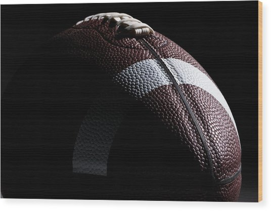 Close-up Of American Football With Dramatic Lighting Wood Print by Kledge