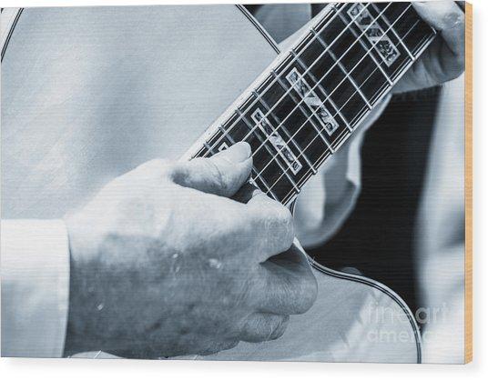 Close Up Of Guitarist Hand Strumming Wood Print