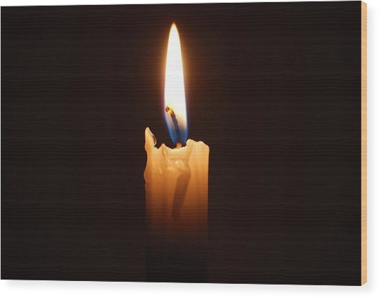 Close-up Of Lit Candle In Dark Room Wood Print by Lau Vzquez / EyeEm