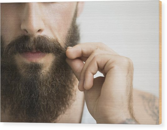 Close Up Of Man Touching Mustache Wood Print by Hero Images