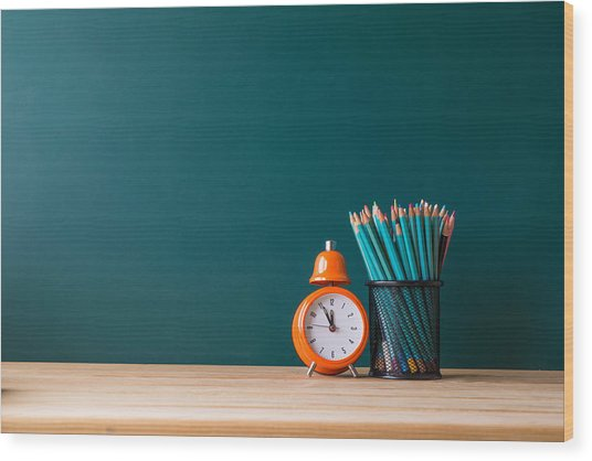 Close-up Of Pencils In Container By Alarm Clock On Table Wood Print by Shih Wei Wang / EyeEm