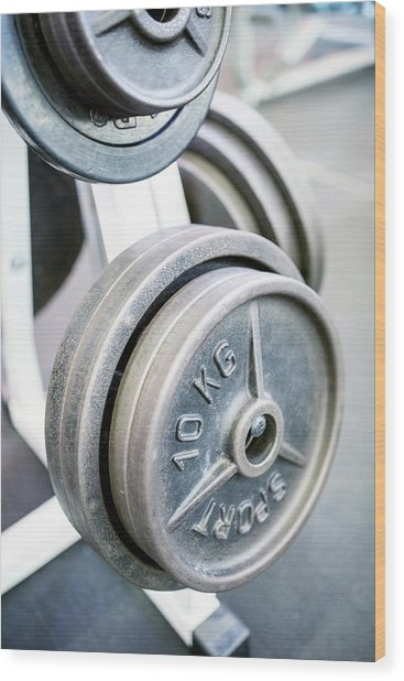 Close-up Of Weight Plates Wood Print by Science Photo Library