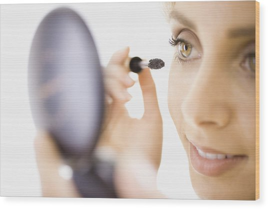 Close-up Of Woman Applying Makeup Wood Print by Jupiterimages, Brand X Pictures