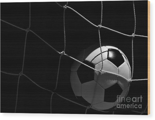 Closeup Of Soccer Ball In Goal Wood Print