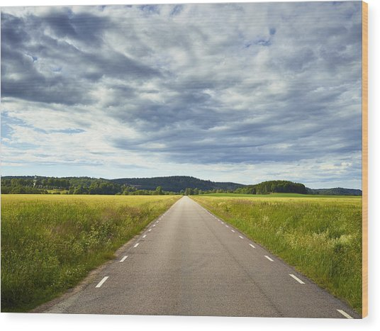 Clouds Above Country Road Wood Print by Johner Images