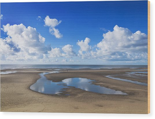 Clouds Across The Beach Wood Print