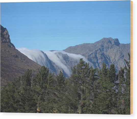 Clouds Flowing Over The Mountains Wood Print