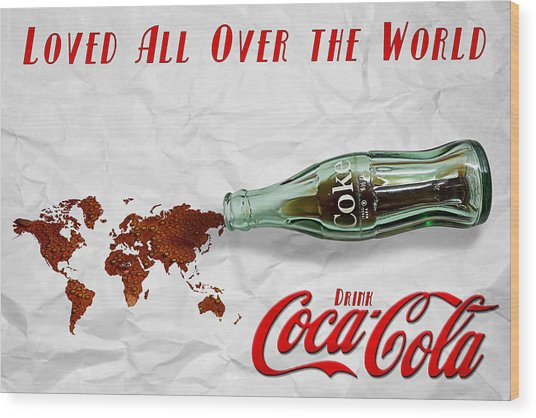 Coca Cola Loved All Over The World Wood Print