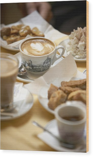 Coffee Drinks And Biscotti On Table In Cafe (focus On Cappuccino) Wood Print by Bob Handelman