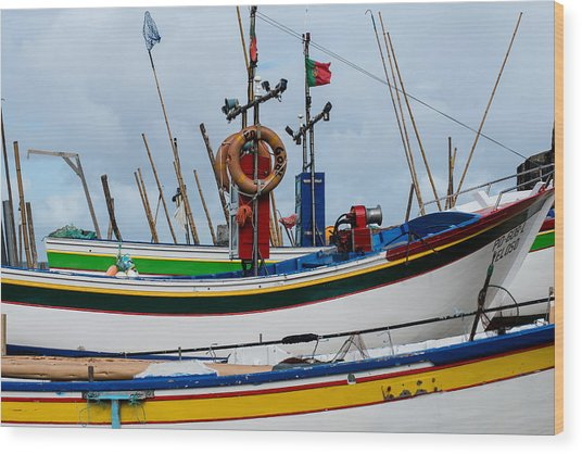 colorful fishing boat with Portuguese flag  Wood Print