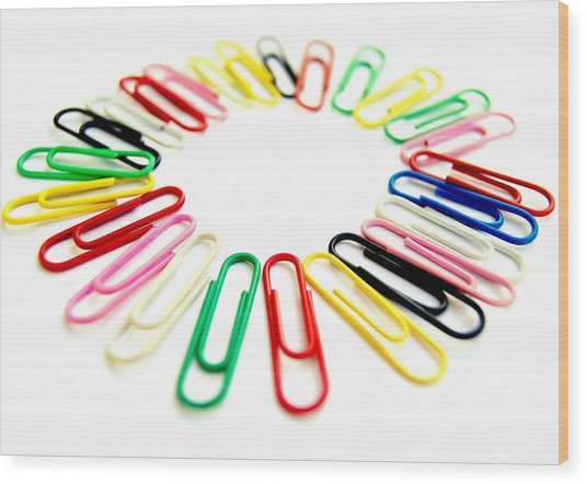 Colorful Office Clips Arranged In A Circle In A White Background Wood Print by Blanchi Costela