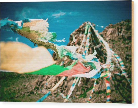 Colourfull Praying Buddhist Flags Lungta And Mountain At Background Wood Print