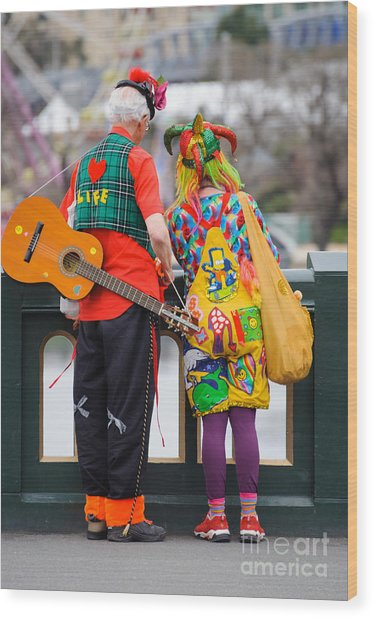 Colourfully Dressed Buskers Pause On The Way Home Wood Print