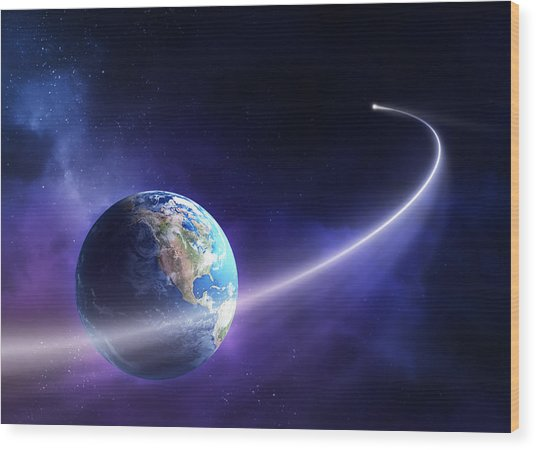 Comet Moving Past Planet Earth Wood Print