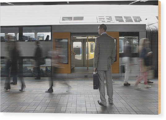 Commuters Passing Businessman On Platform,  (blurred Motion) Wood Print by Toby Burrows