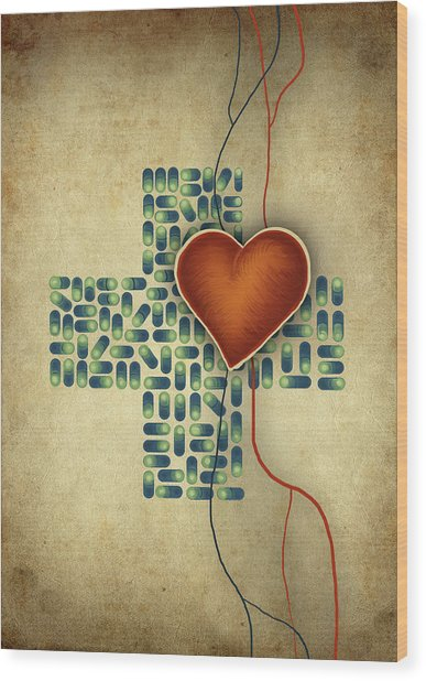 Conceptual Illustration Of Heart Over Cross Shaped Capsules Wood Print by Fanatic Studio / Science Photo Library
