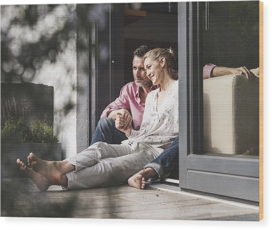Content Mature Couple Relaxing Together At Open Terrace Door Wood Print by Westend61