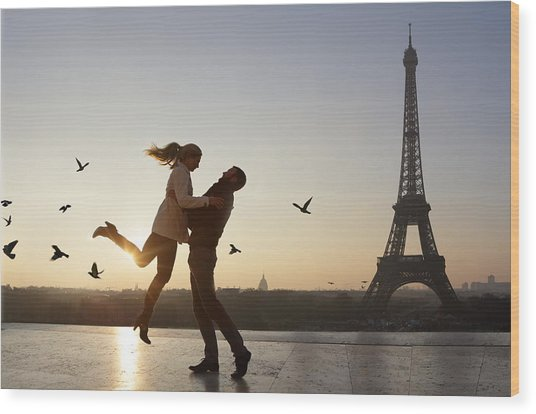 Couple Embracing, View Of Eiffel Tower Wood Print by Peter Cade