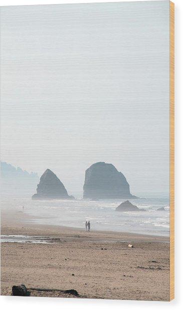 Couple Walking On Rocky Beach Wood Print by Carolyn Hebbard