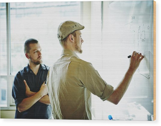 Coworkers Working On Project On Whiteboard Wood Print by Thomas Barwick