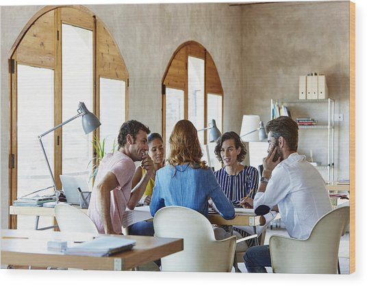 Creative Business People Discussing In Office Wood Print by Morsa Images