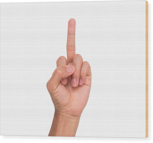 Cropped Image Of Person Showing Middle Finger Against White Background Wood Print by Wichai Treethidtaphat / EyeEm