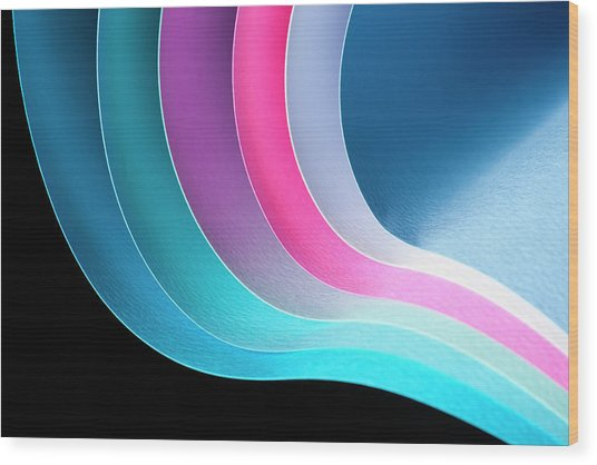 Curves Of Colored Papers On Black Wood Print by Colormos