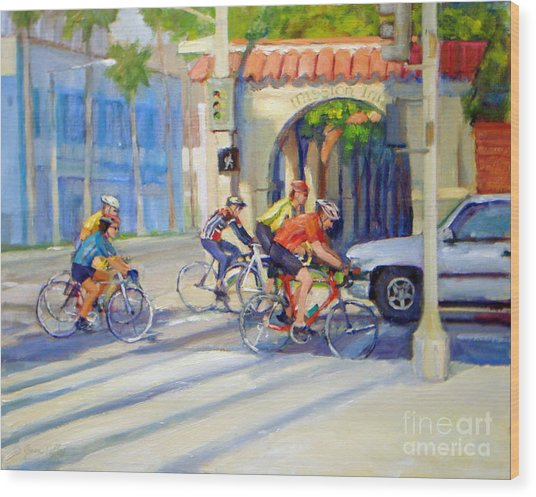 Cycling Past The Archway Wood Print