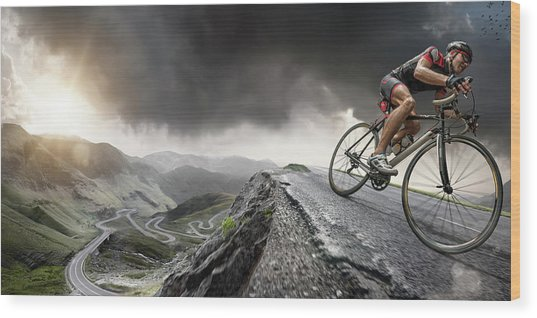 Cyclist Climbs To The Top Wood Print